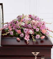 Pink and purple casket flowers and other sympathy gifts delivered daily to Grand Rapids, Rockford, Byron Center and worldwide with Sunnyslope Floral