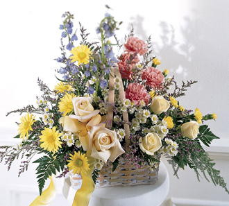 Fresh flowers in a basket for sympathy from a friend or business delivered same day for the funeral home or home address by Sunnyslope Floral