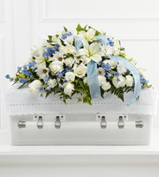 Send white and blue casket spray flowers for same day delivery to Grand Rapids, Walker, Holland, Byron Center and Grandville with Sunnyslope Floral
