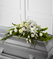 Order & send white lily & other flower casket sprays from the family to funeral homes in the Grand Rapids Mi area & world wide with Sunnyslope Floral